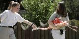 Zookeeper Dawn Cummings, left,  helps veterinary technician Mary Jo Willis with a flamingo she...