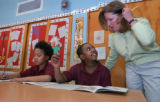 (DENVER, Colo., Apr. 14, 2005) Nancy Dolan (cq), right, a reading assistant at Knight Fundamental...