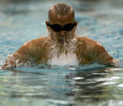 Regis Jesuit High School freshman Jay Kim cuts through the water during his 100-yard Breaststroke...