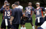 A jersey, #84, not used to being in the back of the Denver Broncos team stretch is worn by rookie...
