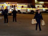 A Denver Police officer leaves Denver Health emergency wing located at 777 Bannock in Denver,...