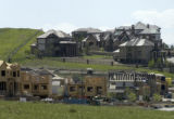 New homes go up in the RidgeGate area of Lone Tree Monday, May 23, 2005. Single family permits in...