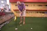 John Jewsbury (cq) of Golden tries out a putter in the putting area of a new Goldsmith store in...