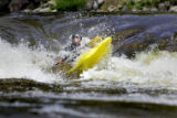 Ian Schwendy (cq), 30, of Boulder rides out of a chute in his kayak on Boulder Creek Tuesday May...
