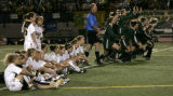 Mountain Vista High School erupts as they beat Arapahoe High School 2-1 during a shoot out to win...