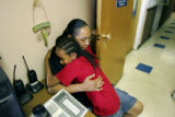 Warren Two Crow Jr. (cq), 8, hugs his mother Heather Two Crow (cq) at the Samaritan House, a...