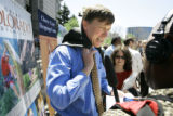 Mayor John Hickenlooper (center) talks with a reporter after a press conference about tourism in...