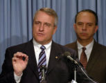 (DENVER, CO. January 5, 2005)   Denver District Attorney Bill Ritter speaks as Denver Police Chief...
