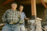In Sedalia, father and son masons, Adam and Kurt Baal work on laying rock on a barn structure. ...
