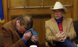 (DENVER, Colo., January 5, 2005) Jon Lipsky,left, wipes sweat from his brow as Wes McKinley,...
