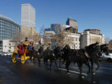 (DENVER Colo., January 6, 2005)  Scott Smith (brown coat - left - driver) leads his team of black...