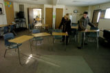 (PARKER Colo., January 12, 2005) Mary Renton (left) and Luke Simington (right) arrange desks in...