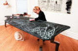 (Denver, Co.-Jan. 13, 2005)  Zoe Wooldridge, 7, uses chalk to draw on a dining table built by her...