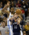 Denver, Colo., photo taken January 21, 2004: Denver Nuggets center Marcus Camby, left, applies...