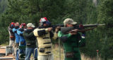 Dan Gabel (cq), right, from Thornton, takes part in a NRA Sanctioned Match Sunday morning...
