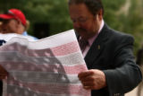 Jefferson County Commissioner Jim Congrove(cq) hold a flag inscribed with all the names of those...