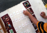 Denver, CO., April 28, 2004)  Ali Salgado, 5, of Centro Tlaloc School spells the word represented...