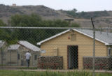 MJM1138   A man walks inside the  fenced in confines of Camp George West Monday afternoon in...
