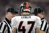 (INDIANAPOLIS, Ind. - Shot 1/9/2005) The Denver Broncos' John Lynch (#47, S) talks with a couple...