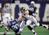 (INDIANAPOLIS, Ind. - Shot 1/9/2005) The Denver Broncos' Jeb Putzier (#88, TE) tackles  the...