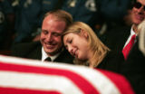 Nathan Bantau and his wife Nicole Bantau, daughter of slain Police Officer Michael D. Thomas, find...