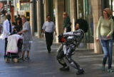 "Michael Potts (cq) ""Robo-Mike"" keeps them laughing on the 16th Street Mall Tuesday..."