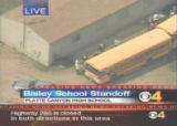 BAILEY, Colo. - A gunman took at least five students hostage at the high school in this tiny...
