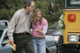 Platte  Canyon high school, counselor Jim Orcutt helps a student who got off a buss that...
