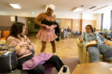 Yvonne Galvin(cq), 49, center, shows off a skirt she just got to Antonia Soliz(cq), 32, left, and...