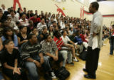 "Kenyon Martin addresses students at Montbello High School during a ""Pass"" on violence..."