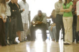 Kenyon Martin is introduced as he prepares to address students at Montbello High School during a...