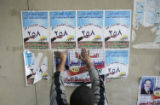 NYT13 - (NYT13) BAGHDAD, Iraq -- Jan. 23, 2005 -- IRAQ-ELECTION -- An Iraqi man puts up an...