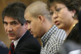 (L-r) Public defender Fernando Freyre(cq) and Raul Gomez-Garcia listen to Judge Larry Naves (not...
