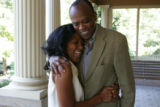 Myrtle-Rose Greene, 55, and her husband, Gerald Padmore, 62,  on the front porch of their home on...