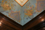 Original painted canvas adorns the ceiling above the molding in the dining room of Myrtle-Rose...
