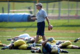 University of Northern Colorado first year head football coach Scott Downing (center) presides...