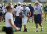 University of Northern Colorado head football coach Scott Downing (far right) sends freshman...