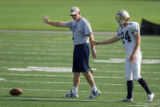 University of Northern Colorado head football coach Scott Downing (left) works with freshman...