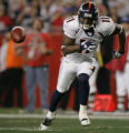 (JPM1122) - Denver Broncos newly-acquired kick returner Quincy Morgan chases the ball on a punt by...