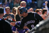 Colorado Rockies Vinny Castilla celebrates with teammates after scoring in the bottom of the 4th...