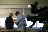 MJM651 The Archbishop Desmond Tutu is fitted for a microphone by cameraman, Rob Dykes (cq) of...