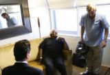 MJM708 The Archbishop Desmond Tutu glances up to cameraman, Rob Dykes (cq) of Independent...