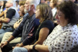 Roberta Schuster(cq), right, of Pueblo County West-North, weeps during testimony about the...