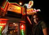 MJM183  Wendy Woo (cq) poses Wednesday evening outside the  24 hour restaurant, Pete's Kitchen in...