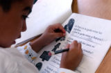 Denver, CO., April 28, 2004)  Luis Ochoa, 6, of Centro Tlaloc School works on reading...