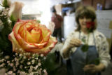 A confetti rose stands tall in a one of dozens of bouquets that Nancy Anderson, CQ, owner of...