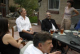 MJM959 Alyssa James (cq), left center, sits in the backyard of her home along with her aunt,...