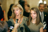 Kelly Young (left), the widow of detective Donald Young, and their daughter Kourtney (cq), 15,...