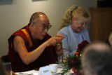 MJM1833 The Dalai Lama, left, points across the table to the Archbishop Desmond Tutu as he sits...