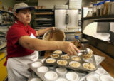(Louisville, CO. January 6, 2005)  Amada Ramos, a baker at Karen's in the Country, a Louisville,...